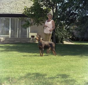 Primary view of object titled '[Marion Mauldin with Doberman]'.