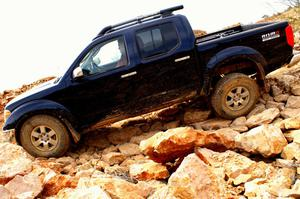 Primary view of object titled '[Black truck going down rocky slope]'.