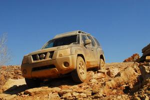 Primary view of object titled '[Dirty SUV  descending rocky slope]'.
