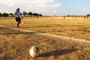 Primary view of object titled '[Sideline official at soccer game]'.