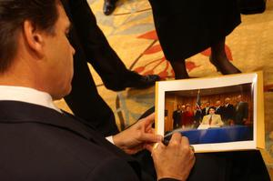 Primary view of object titled '[Rick Perry gives an autograph]'.