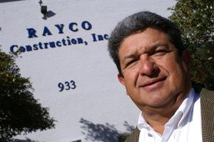 Primary view of object titled '[Ray Gomez in front of building]'.