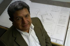 Primary view of object titled '[Ray Gomez looks up at camera]'.