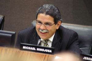 Primary view of object titled '[Michael Hinojosa smiling at microphone]'.