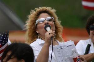 Primary view of object titled '[Mary Dominguez holding microphone]'.