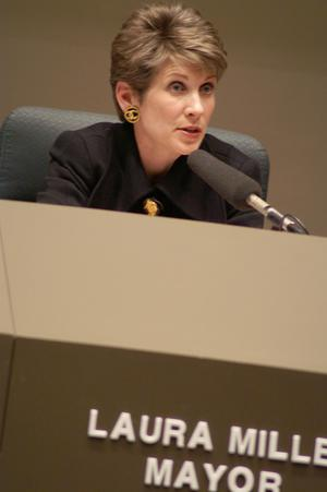 Primary view of object titled '[Laura Miller sitting behind microphone]'.