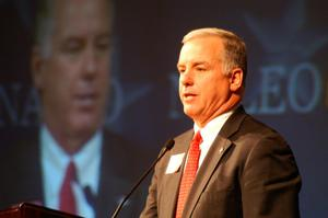 Primary view of object titled '[Howard Dean speaking at podium]'.