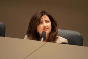 Primary view of object titled '[Elba Garcia sitting during meeting]'.
