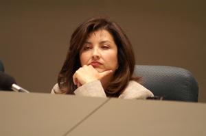 Primary view of object titled '[Elba Garcia listening at meeting]'.
