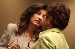 Primary view of object titled '[Elba Garcia speaking with a woman]'.