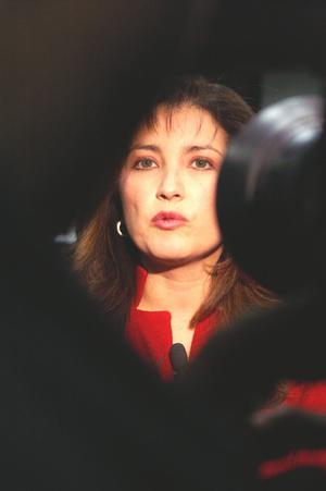 Primary view of object titled '[Elba Garcia being interviewed in front of video camera]'.