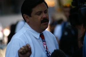 Primary view of object titled '[Domingo Garcia speaking outside]'.