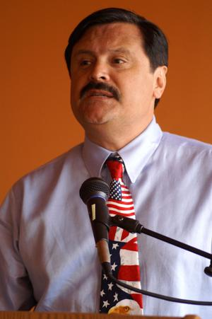 Primary view of object titled '[Domingo Garcia wearing patriotic tie]'.