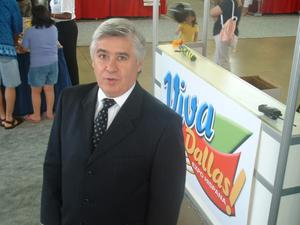 Primary view of object titled '[Arturo Violante standing in front of Viva Dallas booth]'.
