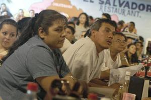 Primary view of object titled '[People gather in the El Salvador Restaurant]'.