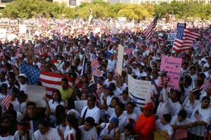 Primary view of object titled '[Large crowd of protesters wave signs and American flags]'.