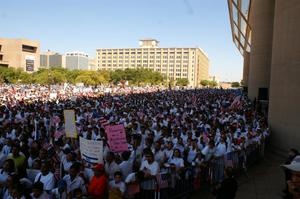 Primary view of object titled '[Immigration protesters gather together in downtown Dallas]'.