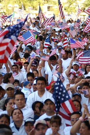 Primary view of object titled '[Large crowd of immigration protesters wave American flags]'.