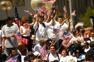 Primary view of object titled '[Immigration protesters waving American flags]'.