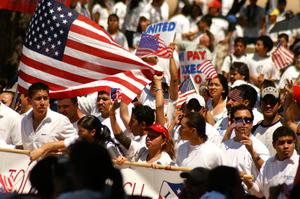 Primary view of object titled '[Protester holds up American flag]'.