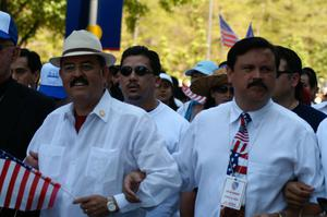 Primary view of object titled '[Hector Flores and Domingo Garcia at the immigration march]'.