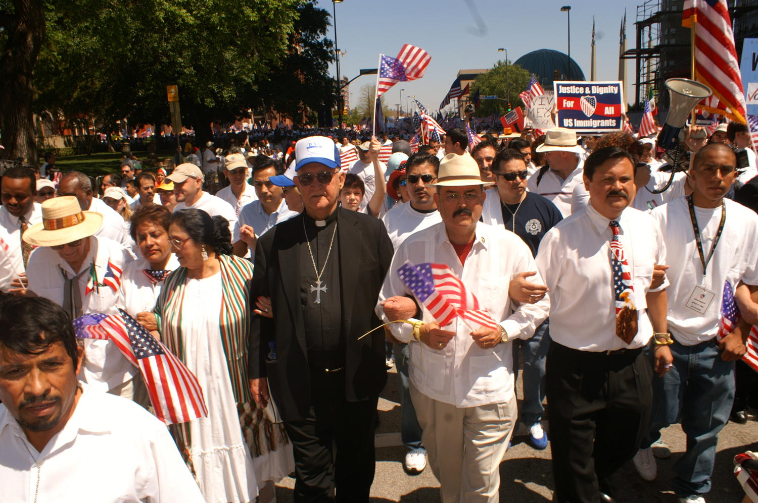 [Immigration protesters march with priest]                                                                                                      [Sequence #]: 1 of 1