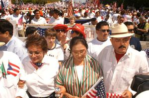 Primary view of object titled '[Immigration Protesters Marching With Signs and American Flags]'.