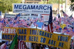 Primary view of object titled '[Signs and American flags at the beginning of the march]'.