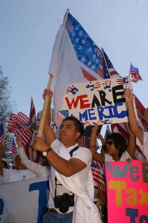 Primary view of object titled '[Male Protester With Large American Flag]'.