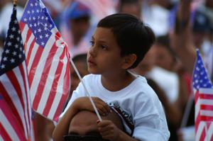 Primary view of object titled '[Boy with American flag]'.