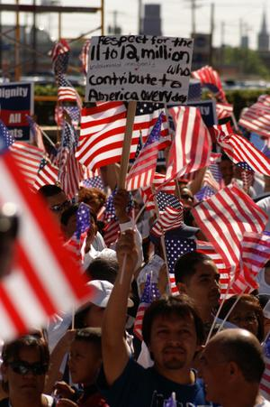Primary view of object titled '[Immigration protesters with American flags and signs]'.