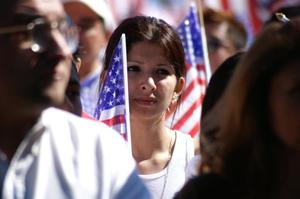 Primary view of object titled '[Woman protester holds an American flag]'.