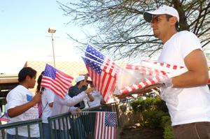Primary view of object titled '[Man gives American flags to immigration protesters]'.