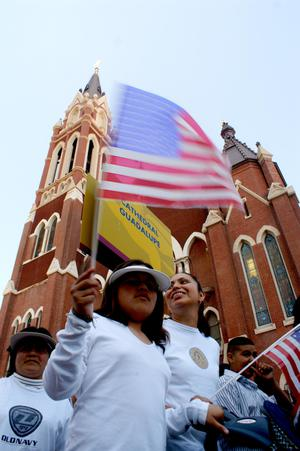 Primary view of object titled '[Protesters march past Cathedral Santuario de Guadalupe in Dallas]'.