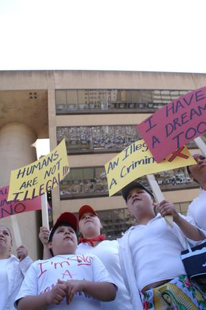 Primary view of object titled '[Protesters carry signs in front of Dallas City Hall]'.