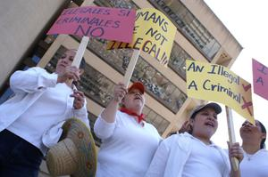 Primary view of object titled '[Women hold up signs in front of Dallas City Hall]'.