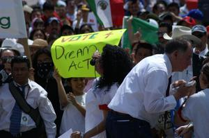 "Primary view of object titled '[""Vote 4 Dream Act"" on sign carried by protester]'."