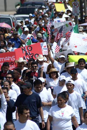 Primary view of object titled '[A line of protesters carry flags and signs]'.