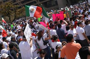 Primary view of object titled '[Protesters wave Mexican flags and signs outside Dallas City Hall]'.