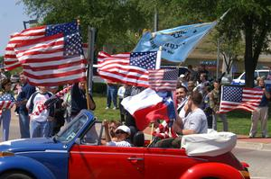Primary view of object titled '[Protesters riding in red, white and blue Volkswagen Beetle]'.
