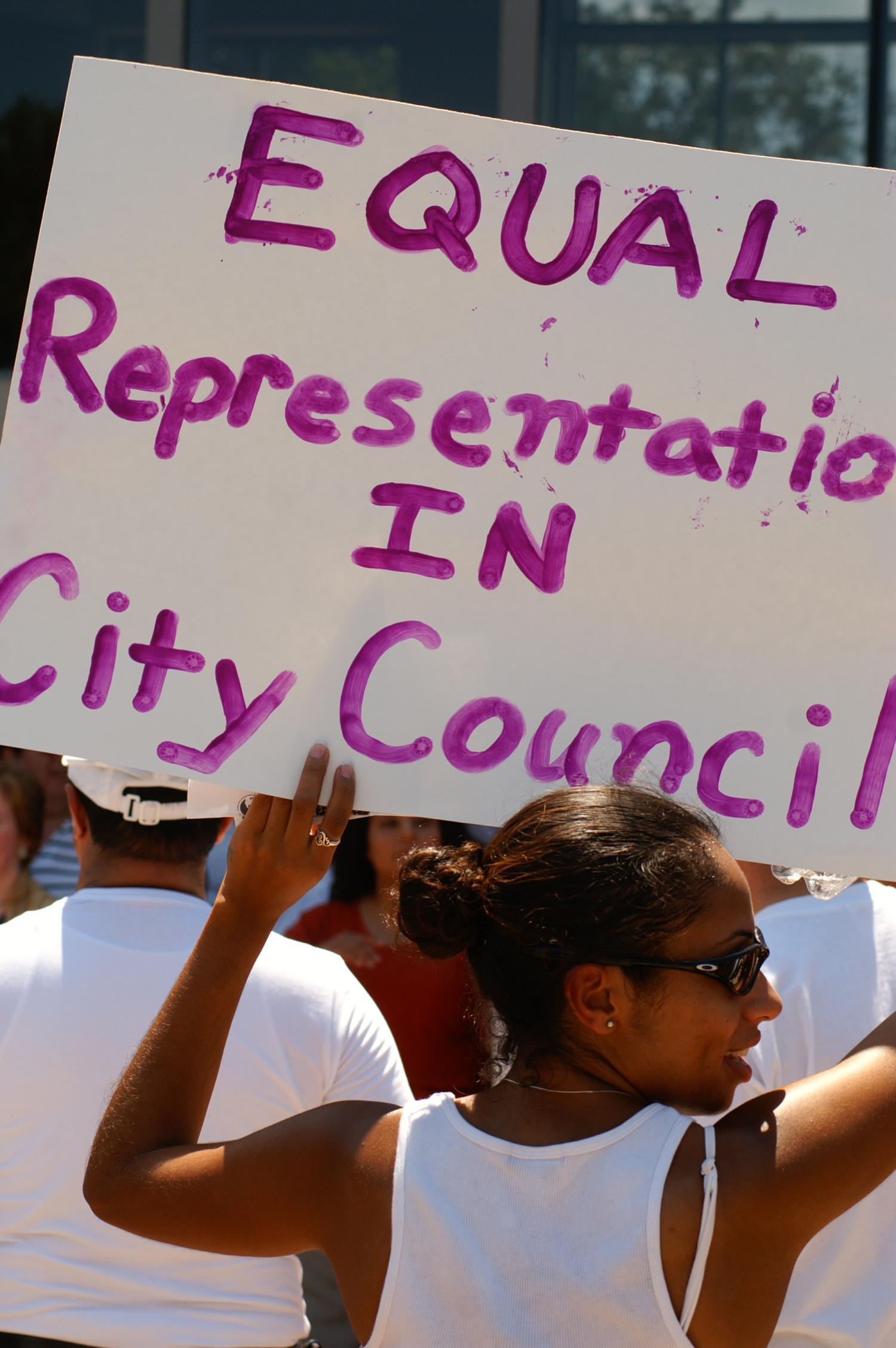 "[Protester holds a sign, ""Equal  Representation in City Council""]                                                                                                      [Sequence #]: 1 of 1"