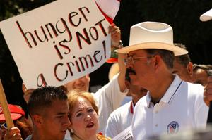 "Primary view of object titled '[Protesters with sign, ""Hunger is not a crime""]'."