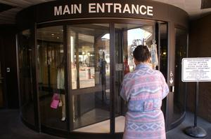 Primary view of object titled '[People walk through JPS main entrance]'.