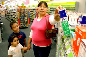 Primary view of object titled '[Isabel Segovia, and her children are seen at a pharmacy in Grand Prairie, Texas]'.