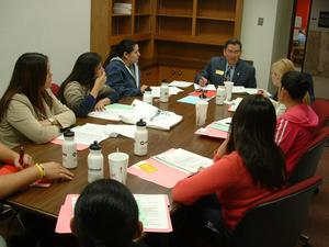 Primary view of object titled '[Rudy Rodriguez leads a class discussion]'.