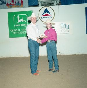 Primary view of object titled '[Paige Hough and man in Youth division award presentation at Will Rogers Coliseum #1]'.