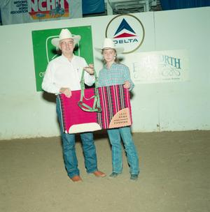 Primary view of object titled '[Man and young woman in Youth division award presentation at Will Rogers Coliseum]'.