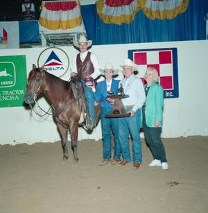 Primary view of object titled '[So Neat Alena and four people in award presentation at Will Rogers Coliseum #1]'.