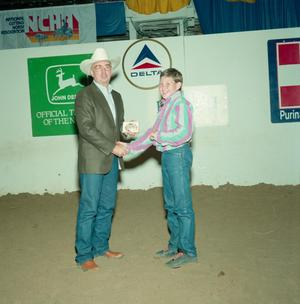 Primary view of object titled '[Lance Welch and man in award presentation at Will Rogers Coliseum]'.