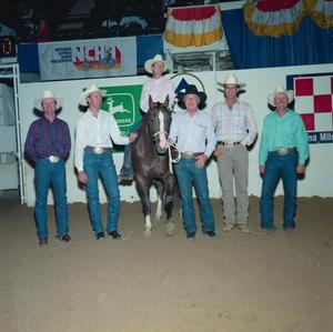 Primary view of object titled '[Six people in rodeo arena at Will Rogers Coliseum]'.